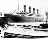 Olympics new lifeboats, ready to be installed. Another source posits that they are Titanic's remaining lifeboats having been brought back to Southampton by Olympic