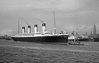 Olympic leaving New York Harbor in October 1934; the Cunard liner is visible behind