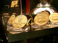 Front three: Manchester United's treble medals of the 1998–99 season are displayed at the club's museum.
