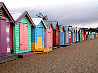 """Bathing boxes at Brighton Beach after an autumn rain storm. Melbourne is said to have """"four seasons in one day"""" due to its changeable weather."""