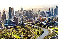 Melbourne's CBD encompasses Southbank (left) and the Hoddle Grid (right), separated by the Yarra River.