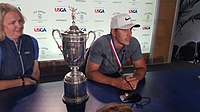 Koepka with the 2018 U.S. Open Trophy at the post-tournament press conference following his win in the event at Shinnecock Hills