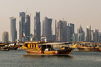 Traditional dhows in front of the West Bay skyline as seen from the Doha Corniche.