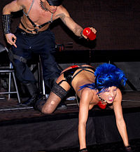 Consensual giving or receiving of pain is legal in Austria. Photo shows wax play at the Eros Pyramide sex show, Austria, 2009.