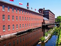 Textile mills such as the Boott Mills in Lowell made Massachusetts a leader in the Industrial Revolution in the United States.