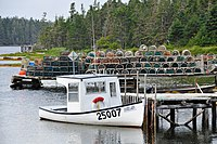 Lobster traps on a dock in Sheet Harbour. The province is the world's largest exporter of lobsters.