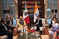 Prime Minister Narendra Modi of India (left, background) in talks with President Enrique Peña Nieto of Mexico during the former's visit to Mexico, June 2016