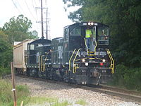 Knoxville and Holston River Railroad MP15AC #2002 leads a train through Tyson Park near downtown Knoxville.