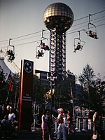 The Sunsphere, with riders aboard a nearby sky-lift during the 1982 World's Fair