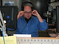 WKMS staff member Tracy Ross hosting his indie rock show, Beyond the Edge.