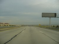 Antelope Valley Freeway looking southbound near downtown Palmdale on a day with sparse traffic.