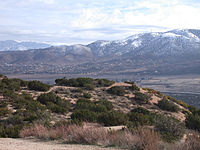 Looking south from the hills near Tierra Subida Avenue, January snow can be seen at the higher elevations.