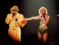 Madonna performing with a Dick Tracy lookalike during the Blond Ambition World Tour, 1990