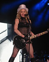 Madonna performing on the 2009 leg of the Sticky & Sweet Tour, which was the second highest-grossing tour of all time