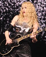 """Madonna playing the guitar riff of """"A New Level"""" by heavy metal band Pantera during the 2008 Sticky & Sweet Tour"""