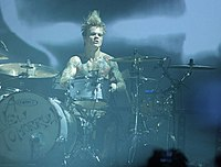 Steve Forrest, shown here during a concert with Placebo in 2009, left the band in 2015 to pursue his own musical career.