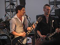 Molko and Olsdal at the Coachella Festival in April 2007. Steve Hewitt and most of his drum kit are out of view.