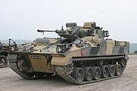 alt=Tank with painted camouflage Warrior IFV