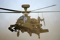 alt=Helicopter in the air AgustaWestland Apache