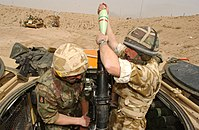 British soldiers from the 1st Battalion, Royal Regiment of Fusiliers battlegroup engage Iraqi positions with an 81mm mortar south of Basra