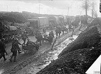 Infantrymen of the Middlesex Regiment with horse-drawn Lewis gun carts returning from the trenches near Albert, France in September 1916. In the background is a line of supply lorries.
