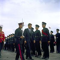 John Fitzgerald Kennedy, escorted by a Bermuda Militia Artillery officer, inspects a Bermuda Rifles guard in 1961, four years before the units amalgamated