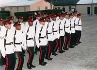 alt=Soldiers in white-and-black dress uniforms Royal Bermuda Regiment on parade