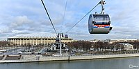 Cable cars passing across the Moskva River and the Luzhniki Stadium