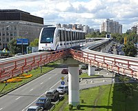 Two trains of the Moscow Monorail arriving at a monorail station
