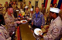 U.S. President George W. Bush visits Iraq to have Thanksgiving dinner with soldiers in 2003