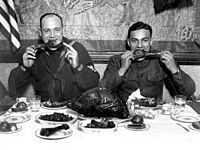 Servicemen eating a Thanksgiving dinner after the end of World WarI (1918)