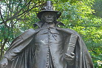 """The Pilgrim by Augustus St. Gaudens, 1904. The """"buckle hat"""" atop the sculpture's head, now associated with the Pilgrims in pop culture, was fictional; Pilgrims never wore such an item, nor has any such hat ever existed as a serious piece of apparel."""