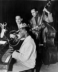 King Cole Trio Time on NBC with Cole on piano, Oscar Moore on guitar, and Johnny Miller on double bass, 1947