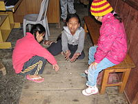 Nepali children playing a variant of knucklebones, with pebbles