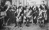 King Haakon (standing, far left) with other European sovereigns at the funeral of King Edward VII, 20 May 1910