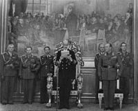 King Haakon VII reading the Speech from the Throne to the Storting in 1950, Crown Prince Olav on his left side