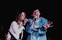 Crow and Mick Jagger on stage during a Rolling Stones concert in 2002