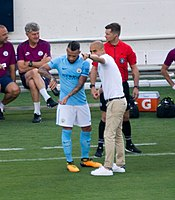 Guardiola giving instructions to Nicolás Otamendi during a friendly match against Tottenham Hotspur in 2017