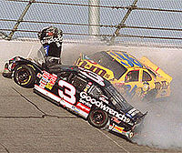 Dale Earnhardt (#3) suffers a fatal accident at the Daytona 500.