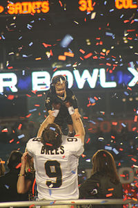 Brees celebrating the Super Bowl win with his son Baylen
