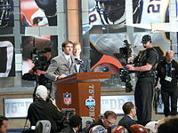 Brees announcing the Saints' draft pick at the 2010 NFL Draft