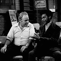 When Archie visits a local blood bank to make a donation, he meets his neighbor, Lionel Jefferson, who is there to do the same thing.