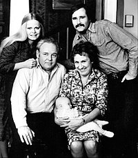 The Bunkers and the Stivics: standing, Gloria (Sally Struthers) and Michael (Rob Reiner); seated, Archie (Carroll O'Connor) and Edith (Jean Stapleton) with baby Joey