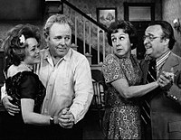 """Vincent Gardenia (before becoming a regular cast member as Frank Lorenzo) and Rue McClanahan played a """"wife-swapping"""" couple who meet the unsuspecting Bunkers in a 1972 episode. L-R: McClanahan, Carroll O'Connor, Jean Stapleton, and Gardenia."""
