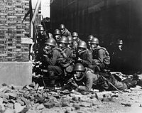 Japanese Special Naval Landing Forces with gas masks and rubber gloves during a chemical attack near Chapei in the Battle of Shanghai