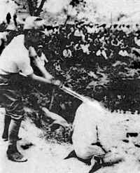 A Chinese POW about to be beheaded by a Japanese officer with a shin gunto