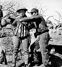 Chinese suicide bomber putting on an explosive vest made out of Model 24 hand grenades to use in an attack on Japanese tanks at the Battle of Taierzhuang