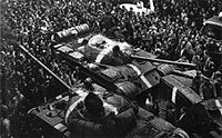 Soviet tanks, marked with white crosses to distinguish them from Czechoslovak tanks, on the streets of Prague during the Warsaw Pact invasion of Czechoslovakia, 1968