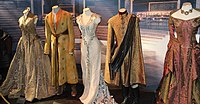 Dresses worn at the royal court in King's Landing indicate their wearers' wealth and status.
