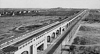 Queens Boulevard, looking east from Van Dam Street, in 1920. The newly built IRT Flushing Line is in the boulevard's median.